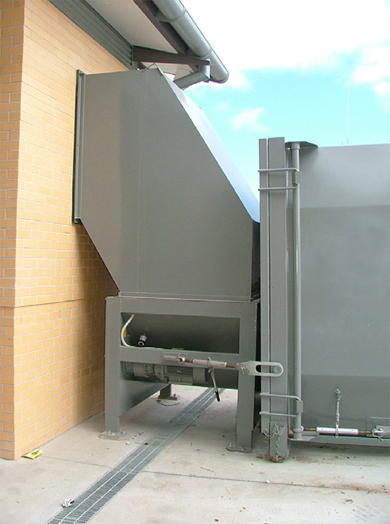 self contained auger connected to a building